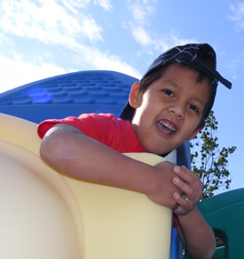 boy top of slide.jpg